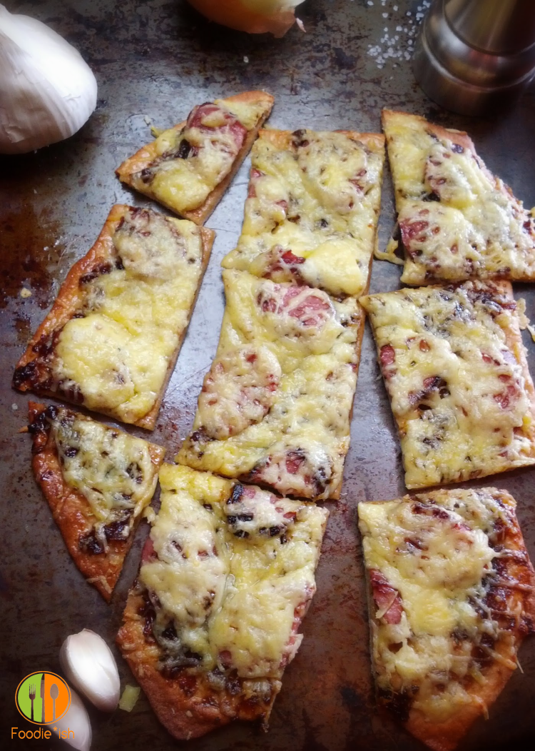 Onion and sausage pizza with gouda