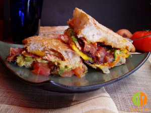 BLT melt with avocado on ciabatta bread with roasted red pepper aioli