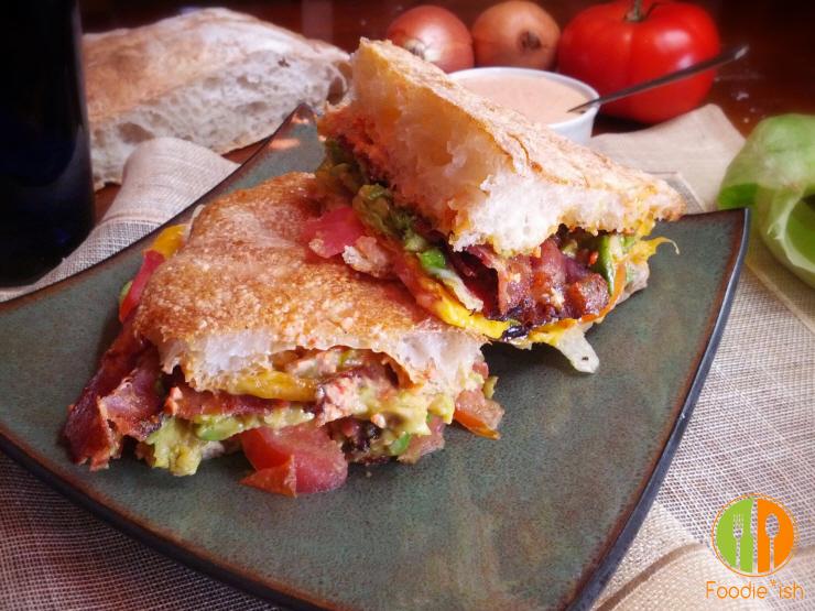 Super yummy avocado BLT melt on ciabatta with roasted garlic-red pepper aioli